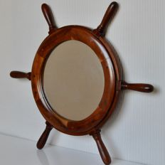 Producer unknown - wooden wall mirror in the shape of a ship's wheel