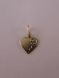 14kt Gold pendant.  Weight: 0.48 g.  Size -  14.80 mm./ 8.75 mm.