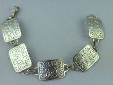 A solid 735 silver bracelet with ornaments from around 1930
