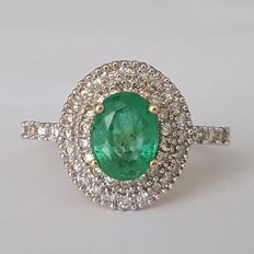 18 kt gold Heritage ring with a 1 ct emerald surrounded by 0.60 ct of diamonds.  Size: 18.1 mm, EU 17/57