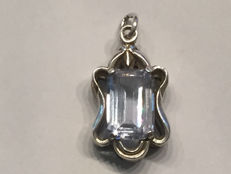 A pendant made of genuine 800 silver and a real quamarine in emerald cut of 3.18 ct