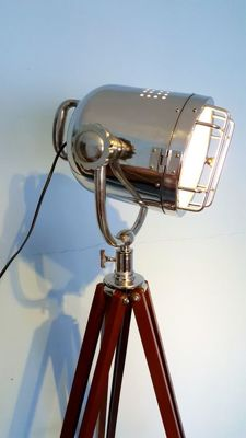 Luxurious chromed lamp on tripod