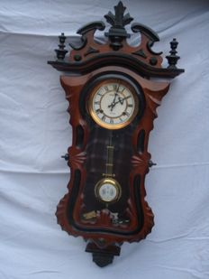 Wooden regulator clock with much carving – Period 1970