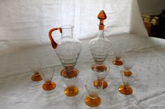 Set of 8 glasses, a wine decanter and a water jug