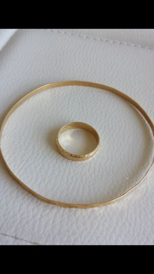 Rigid bracelet and ring made from 18 kt yellow gold