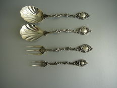 4 Pieces of silver serving cutlery consisting of 2 serving spoons and 2 serving forks, richly decorated, 19th century
