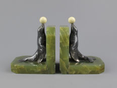 A pair of Art Deco pewter bookends - sea lions with ball