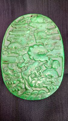 Large jade pendant, with a finely carved representation of a Chinese dragon - 20th/21st century