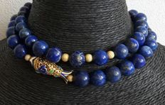 Necklace of natural lapis lazuli with a 24 kt gold-plated fish