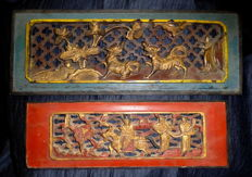 Two wooden Chinese cabinet panels, richly carved with polychrome and partly gold-plated (approxl. 1850)