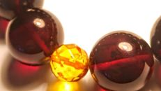 Round beads modified Baltic Amber Cherry colour bracelet with Facet accent ,  Beads diameter ca. 17 mm