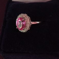 White gold ring set with 117 diamonds totalling 0.40 ct and a natural rose 'pink' tourmaline of 1.10 ct.