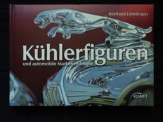 "One book ""Kühlerfiguren"" and care brand emblems"