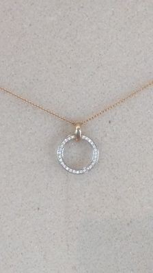 Pendant on necklace 14kt gold with 31 diamonds.