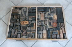 Old industrial letter drawer from a type case of a printing company, with approx. 80 block letters