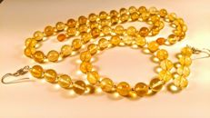 Round beads modified Baltic Amber set of 3, necklace, earrings, bracelet, necklace length 54 cm, 45 gr.