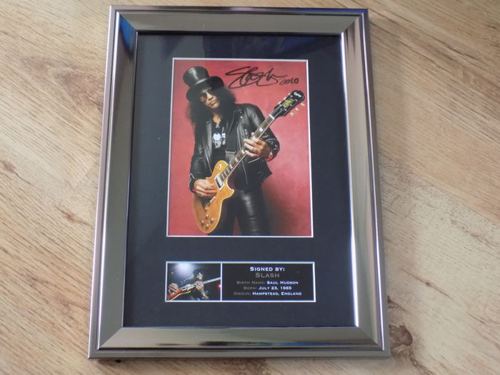 Slash  signed ( printed ) framed photograph.