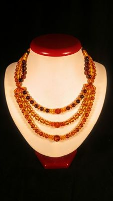 Baltic Amber necklace with ound beads modified colour, length 42 cm, 41 gr.