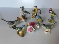 Set of 8 porcelain birds and a flower - England/Germany ca. 1970