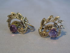 Earrings with amethysts and marcasites.