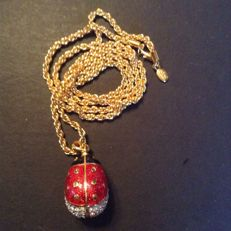 Joan Rivers long necklace with ladybug pendant