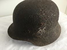 German helmet M-35. WW2 Inner ring, archaeological find. Remains of decal.