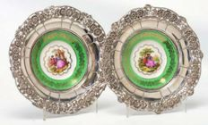 Pair of plates in Limoges porcelain and silver. Europe. 20th century.