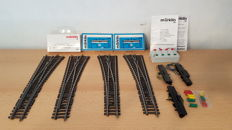Märklin H0 - 2272/2273/7549 - 4 Narrow K-rails switches, 3 electric drives and control console