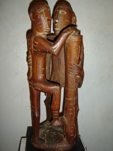 Wooden sculpture of two men with drums - Asmat - West-Papua