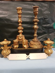 Two candlesticks and a pair of curtain tie backs in gilded wood - Italy - early 19th century