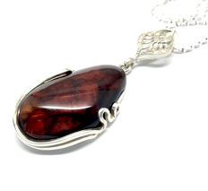 Old sterling silver pendant with real Baltic Amber on silver chain, total weight 15 grams, not pressed Amber