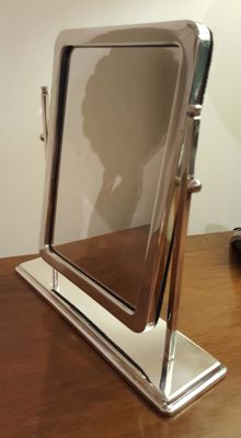Tilting mirror frame in silver