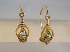 Earrings with light blue spinels.