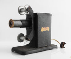 Gucky News vintage magic lantern with a few films