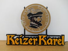 A beautiful illuminated advertising sign for Keizer Karel