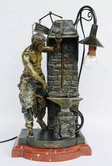'La Veillee Forgeron' - sculpture of a blacksmith at work + lamp - labelled 'Par Rousseau' - bronzed metal cast - ca 1900