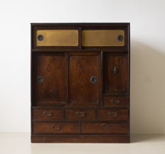 A classic chadansu (tea cupboard).  Simple design and with various drawers and sliding doors – Japan – early 20th century