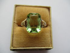 Gold ring with green stone.