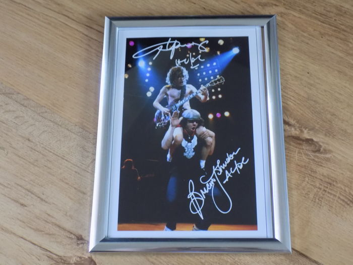 Angus Young and Brian Johnson  signed ( printed ) framed photo print..