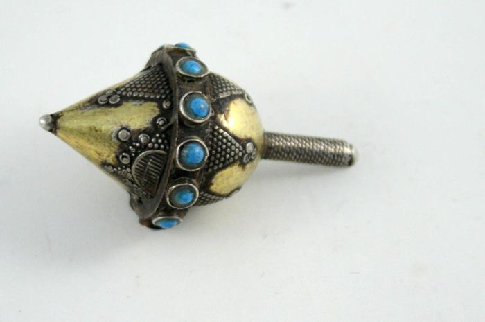 A silver dreidel - decorated with turqoise stones - Turkmenistan - 20th Century
