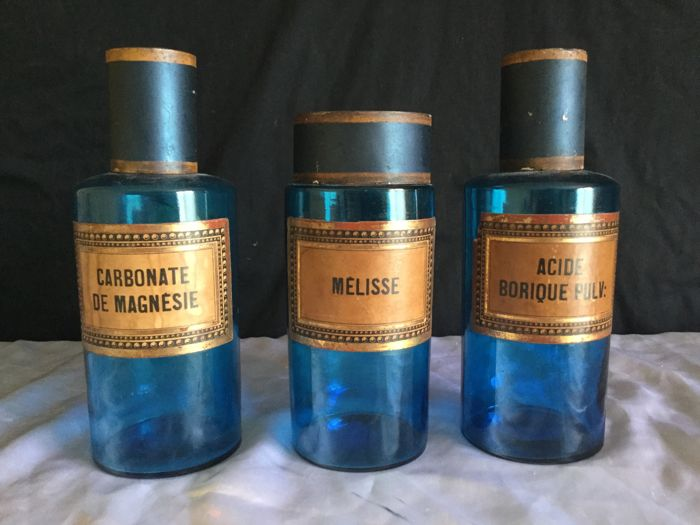 Three blue pharmacy bottles in glass France circa 1950
