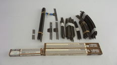Märklin Z - ± 129-piece rails package with curved-/straight-/connecting rails and loose rails pieces