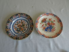 Tichelaar and Porceleyne Fles - Two plates with floral and one with bird and floral decor