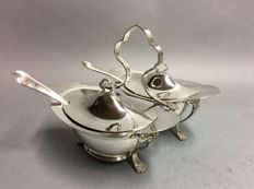 Set of identical silver plated sauce bowls with sauce ladle in a silver plated holder, England, ca 1910