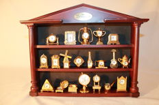 20 miniature gold covered clocks with Swiss machinery with display case - 2nd half 20th century.