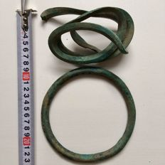 Bronze Age two bracelets for the forearms ( one circle and one spiral resemblic a snake)