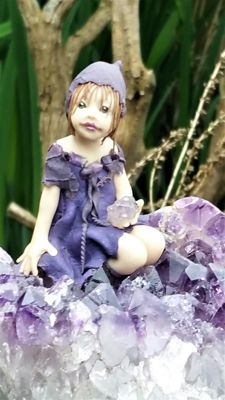 Unique, hand-made statue of elf or other fairytale-like figure  on an amethyst