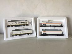 "Märklin H0 - 47348/47885 - Sliding wall car set ""Schenker"" of the ÖBB and a Gas tank carriage set of the SNCF"