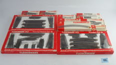 Fleischmann H0 - amongst others 6090 / 6091 / 6092 - Rails package with 3 expansion sets and straight/curved rails, turnouts and detachers
