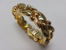 Two-tone 18 kt gold bracelet.